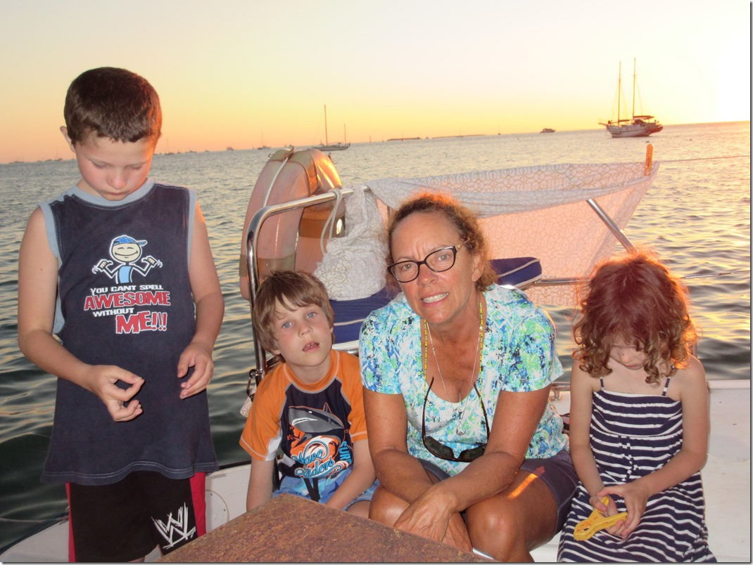Kids accosting Mary from our buddy boat MoonRiver